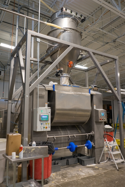 Flour is fed into the mixer from the large hopper above
