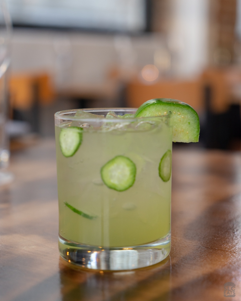 A photo of a green cocktail with jalapeño and tomatillo